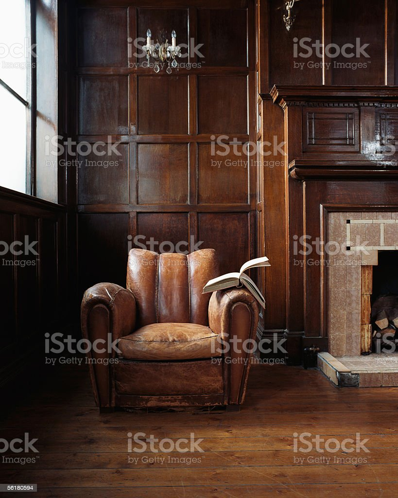 Book on a leather armchair stock photo
