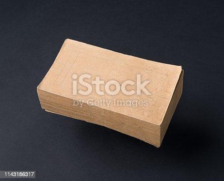 istock book on black background 1143186317