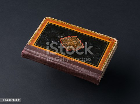 121305595 istock photo book on black background 1143186393