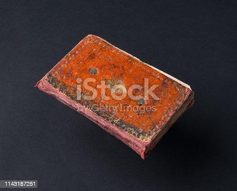 istock book on black background 1143187251