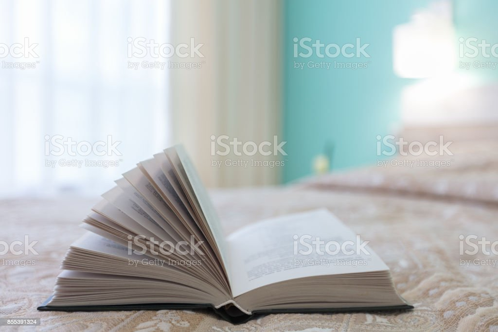 Book on the bead stock photo