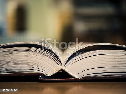 istock book on the table selective focus close view 925943420