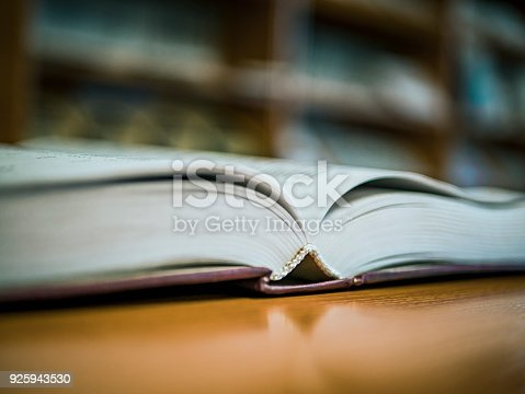 istock book on the table selective focus close view 925943530