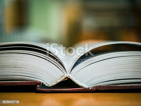 istock book on the table selective focus close view 925943718