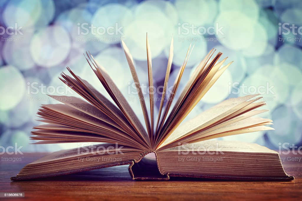Book or bible open on desk stock photo
