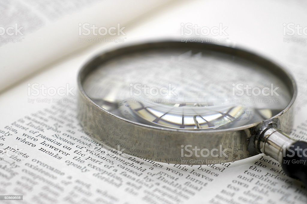 Book Page and Old-Fashioned Magnifying Glass stock photo