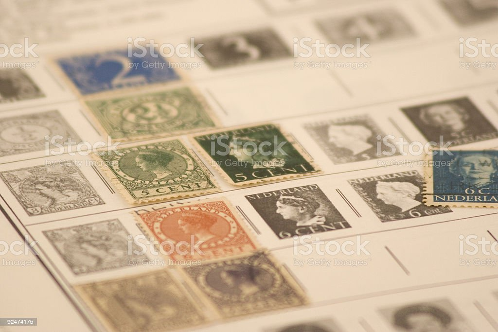 Book Page of Netherlands Stamp Collection: Color royalty-free stock photo