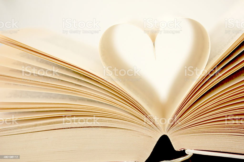 Book pages formed as heart showing concept of love stock photo