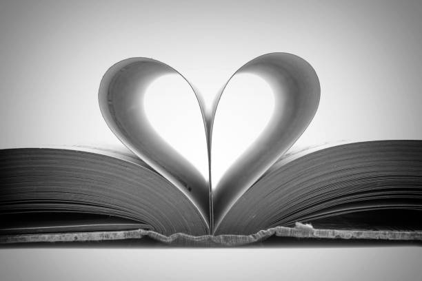 Book pages in the shape of a heart, black and white photography stock photo
