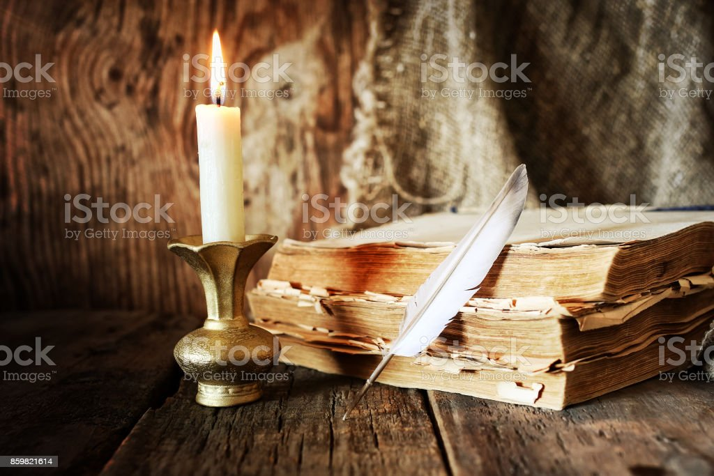book pen candle romance stock photo
