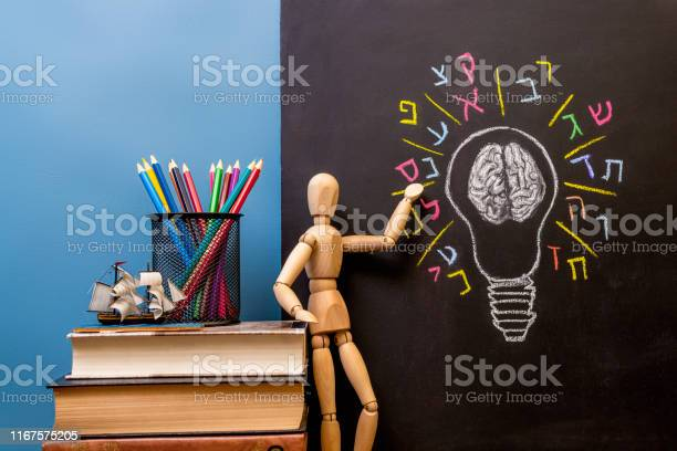 Book pencils and the wooden man standing at the picture light bulb picture id1167575205?b=1&k=6&m=1167575205&s=612x612&h=4hqzdaj 17sbvo0xtswtczbhf3h55ju4sxr5oplxw4s=