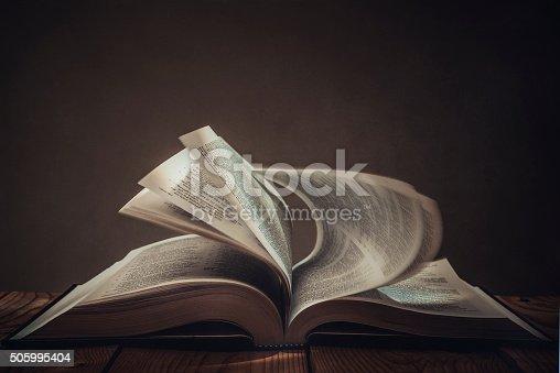 Open book with dark background