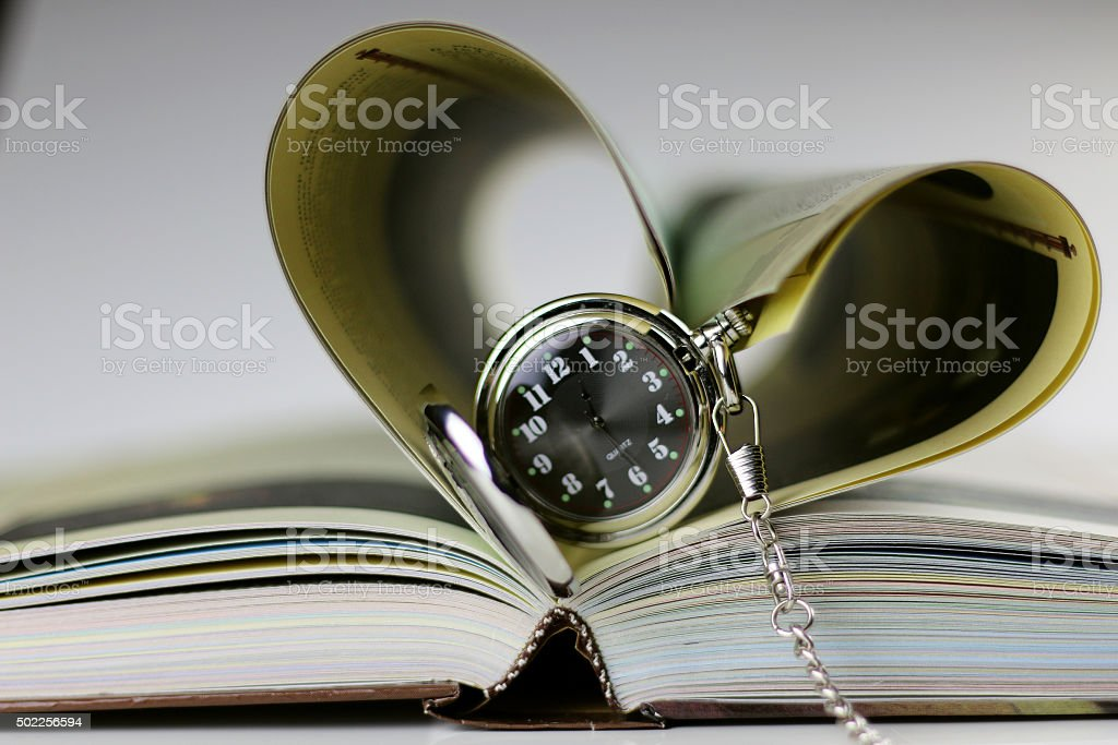 book pocket watch candles stock photo