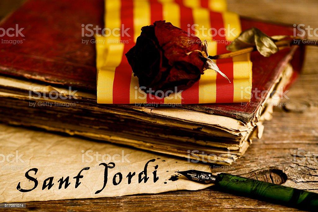 book, rose, catalan flag and text Sant Jordi stock photo