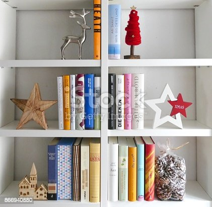 1057183432 istock photo Book shelves filled in form of a christmas tree 866940880