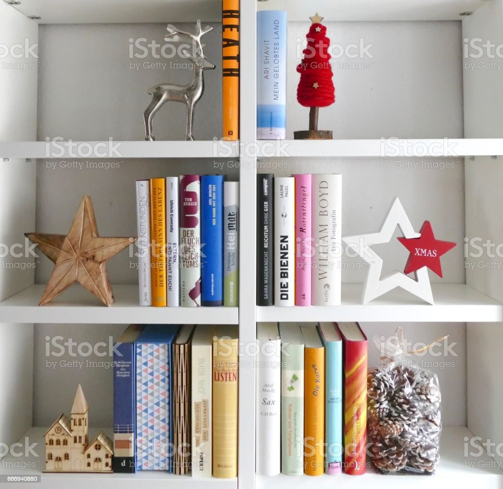 Book shelves filled in form of a christmas tree stock photo