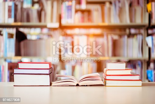 istock Book stack is placed on the library desk. education background, back to school concept. 974627908