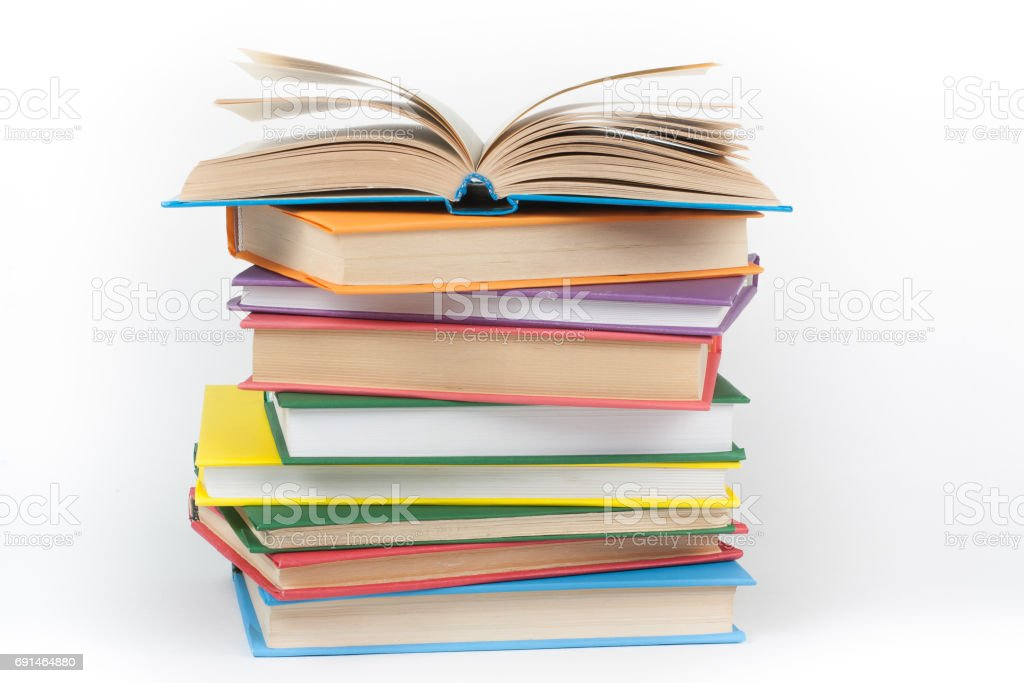 Book stacking. Open book, hardback books on white background. Back to school. Copy space for text stock photo