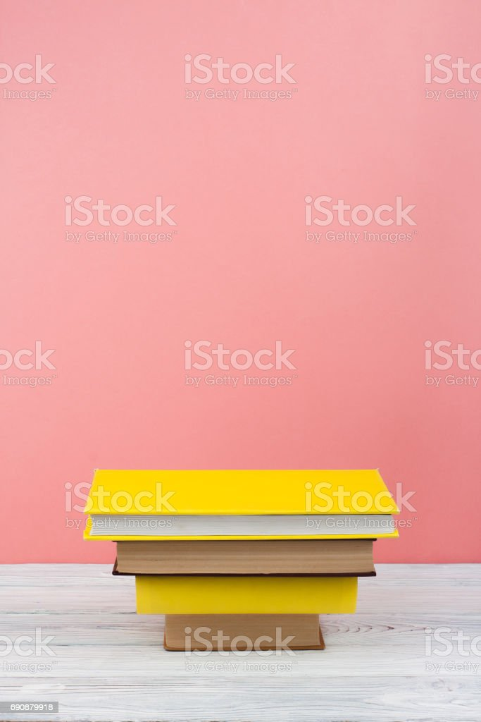 Book stacking. Open book, hardback books on wooden table and blue background. Back to school. Copy space for text stock photo