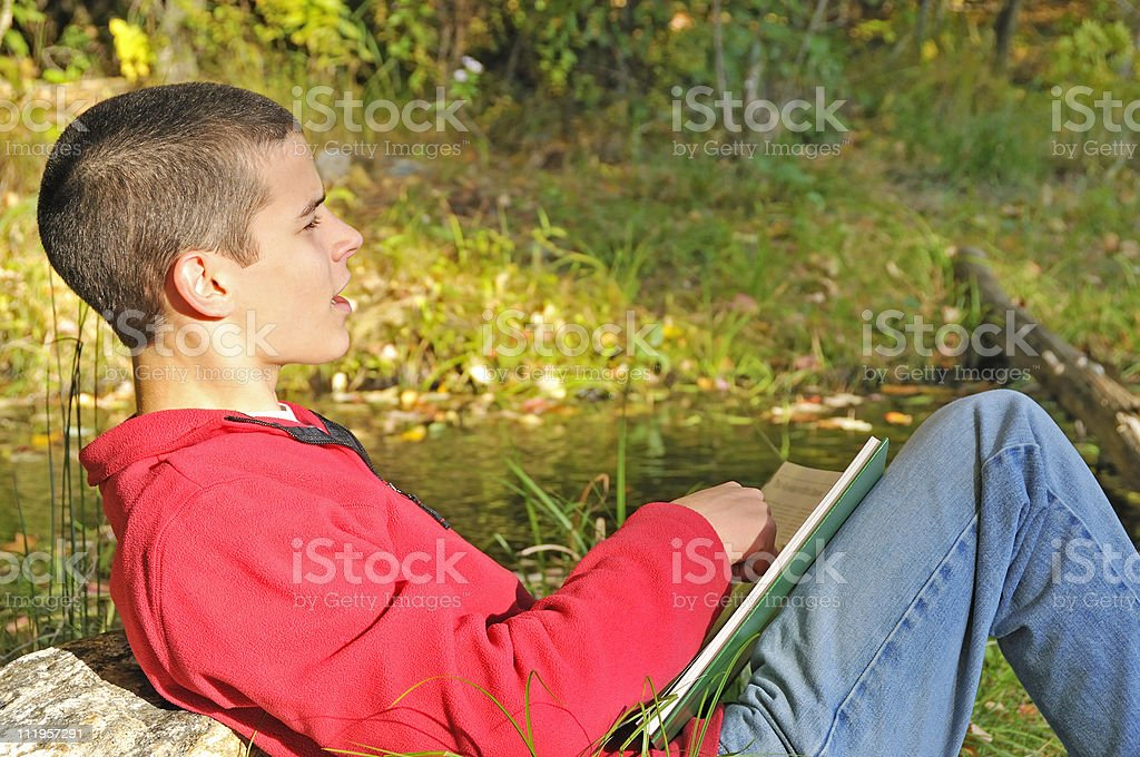 Book Teen Reading Points and Speaks stock photo