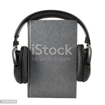 istock Book with a headphones on it, isolated 522646786