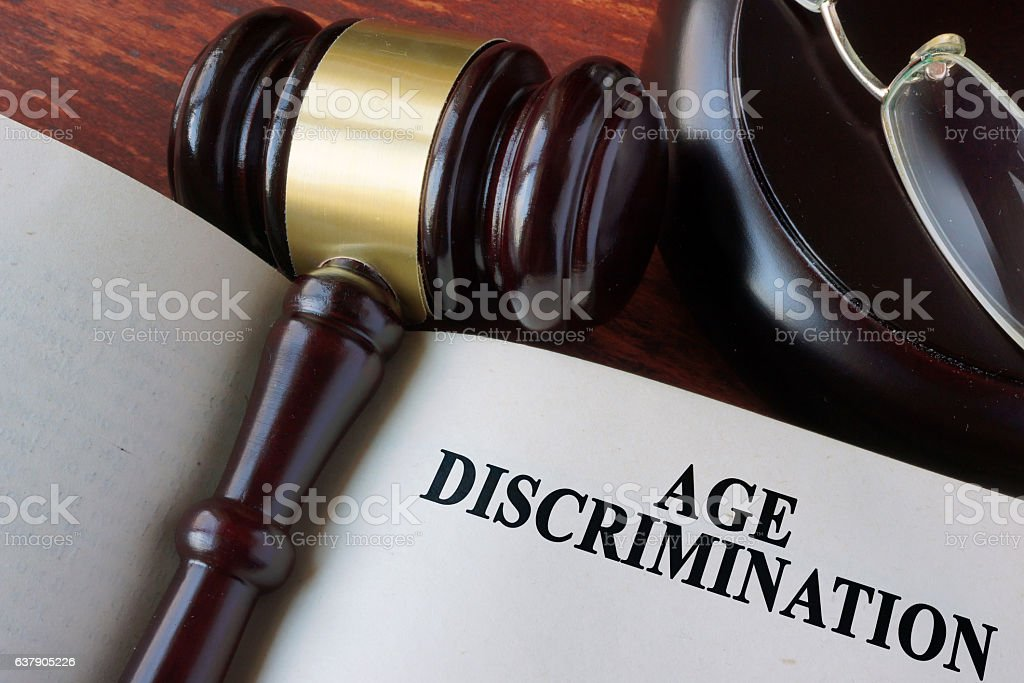 Book with chapter age discrimination and a gavel. stock photo