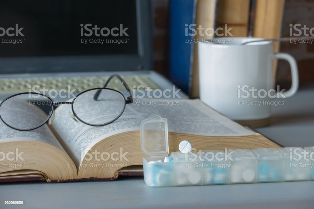 book with drug stock photo