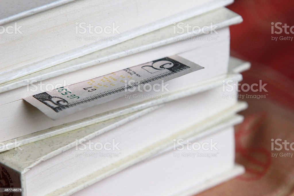 Book with five dollar bookmark stock photo