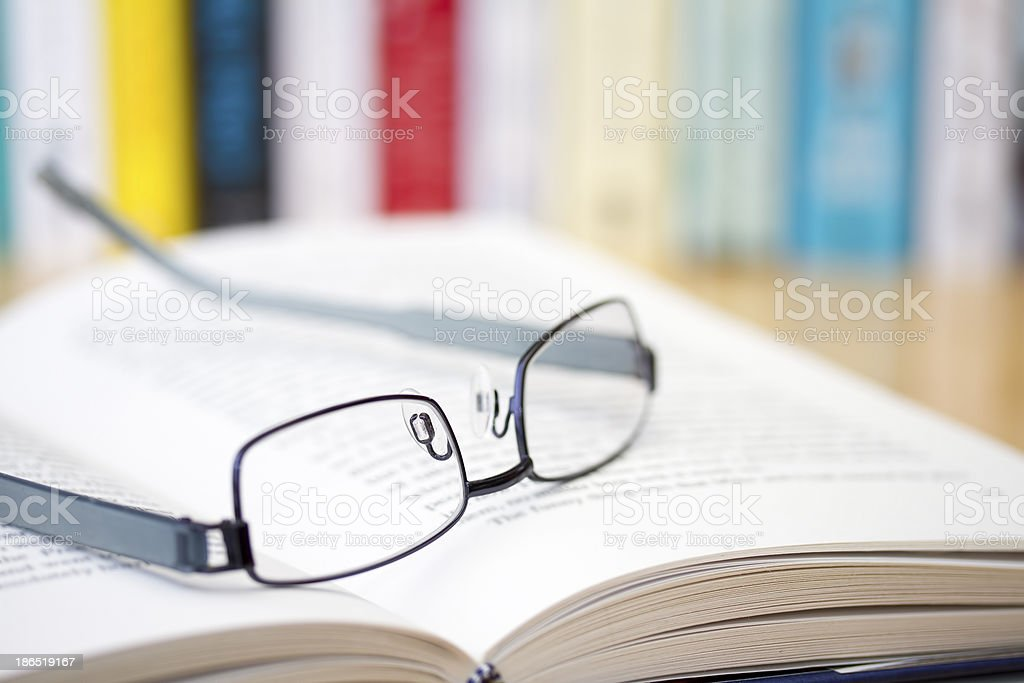 Book with glasses on desk royalty-free stock photo