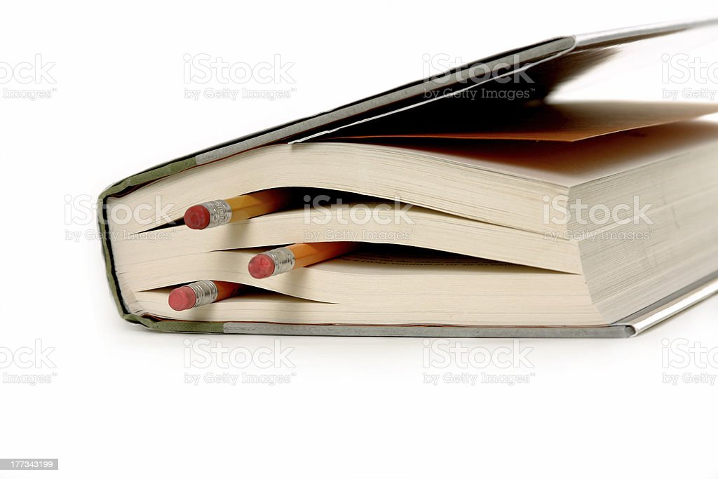 Book with pencils stock photo