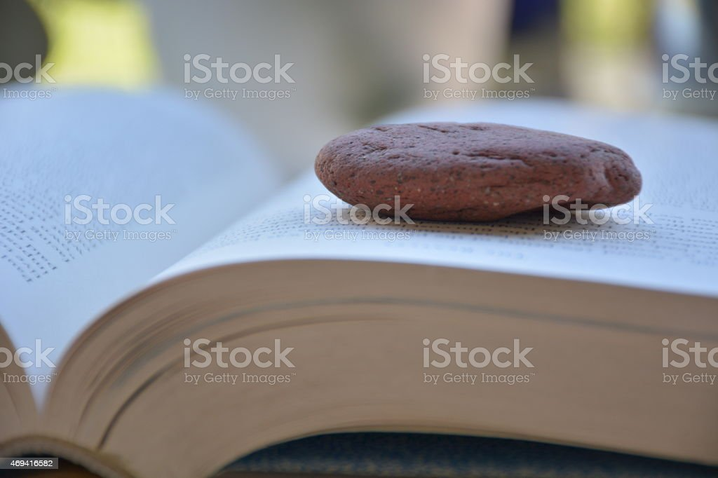 book with stone stock photo