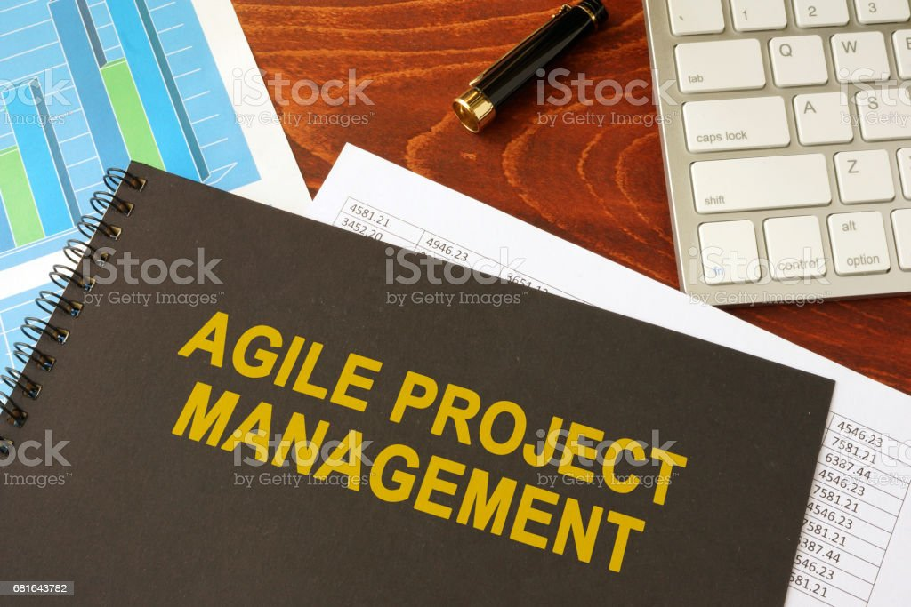 Book with title agile project management in an office. stock photo