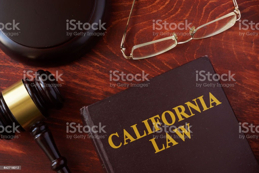 Book with title California law and a gavel. stock photo
