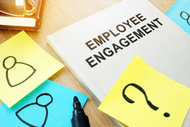 book with title employee engagement on a desk. - employee engagement stock photos and pictures