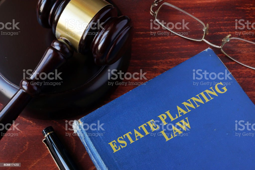 Book with title estate planning law and a gavel. stock photo