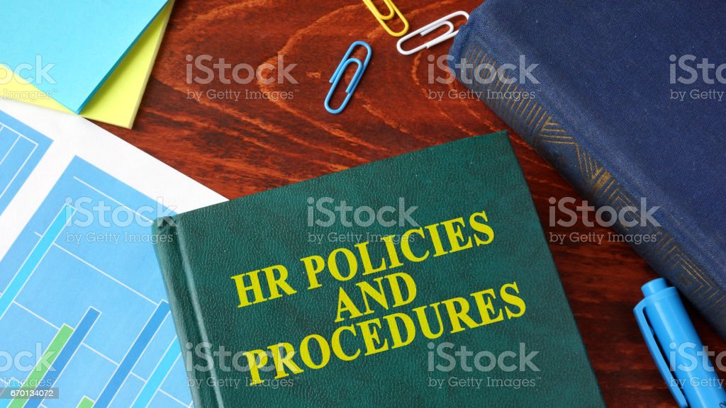 Book with title HR policies and procedures on a table. stock photo