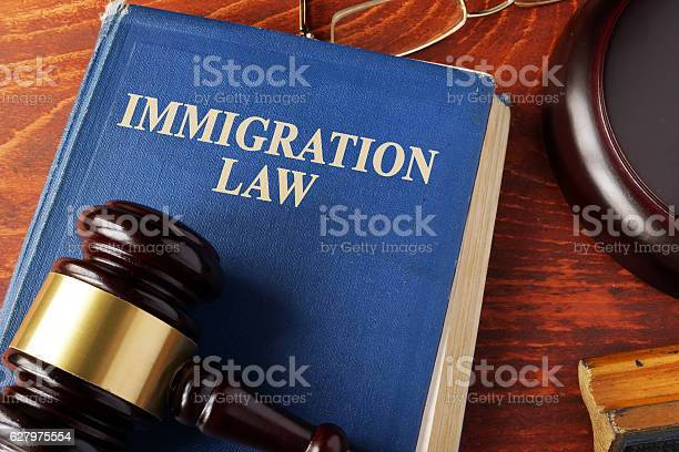 Book with title immigration law on a table picture id627975554?b=1&k=6&m=627975554&s=612x612&h=t cfxm6x2bkoezl07ql zjlqfr5mj5idmkfxu3e3opu=