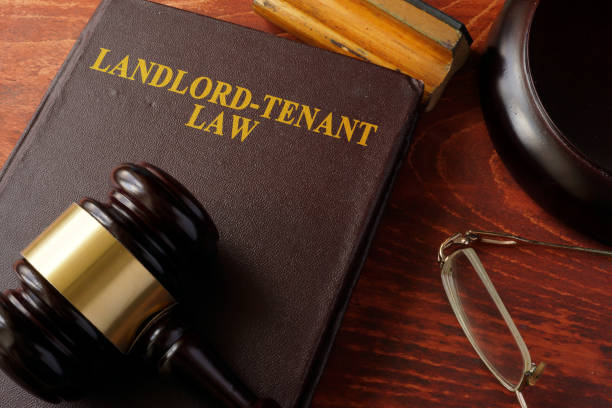 book with title landlord-tenant law and a gavel. - tenant stock photos and pictures