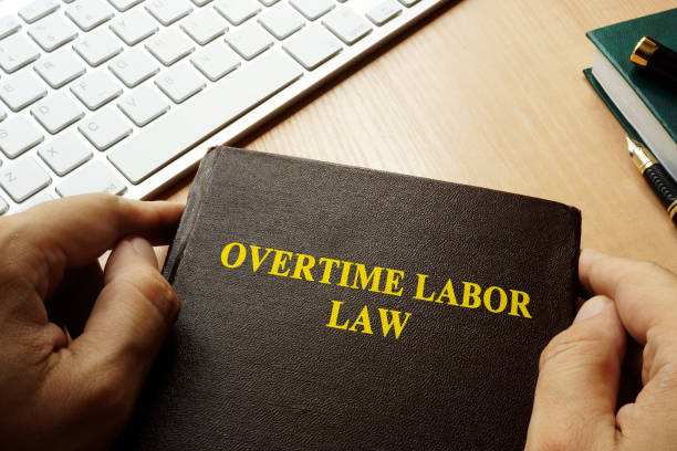 Book with title overtime labor law. stock photo