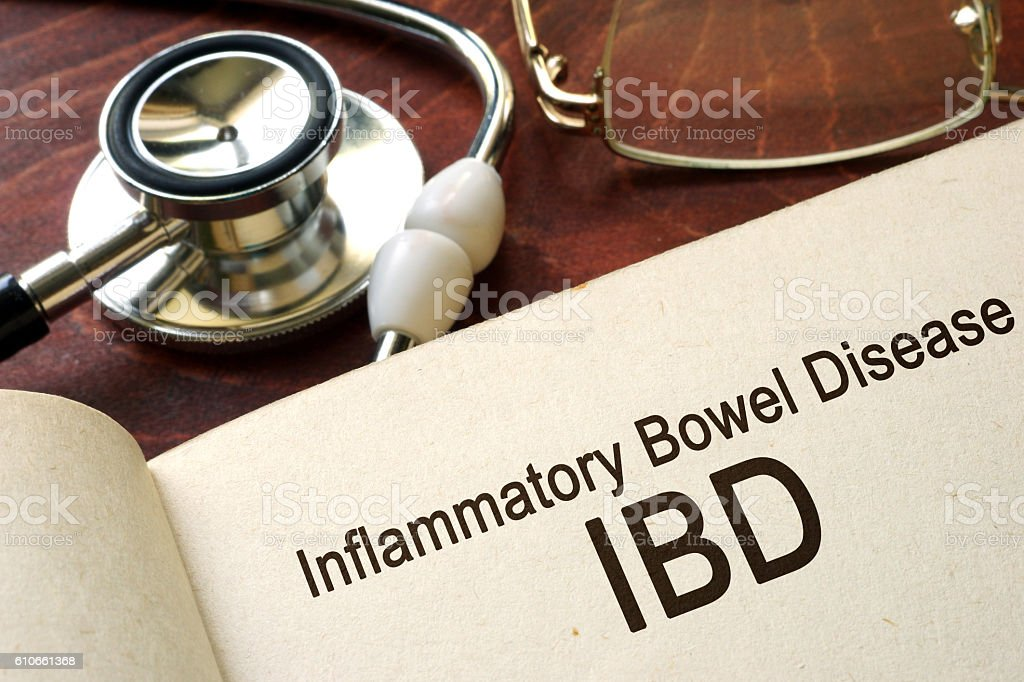 Book with words inflammatory bowel disease IBD on a table. stock photo