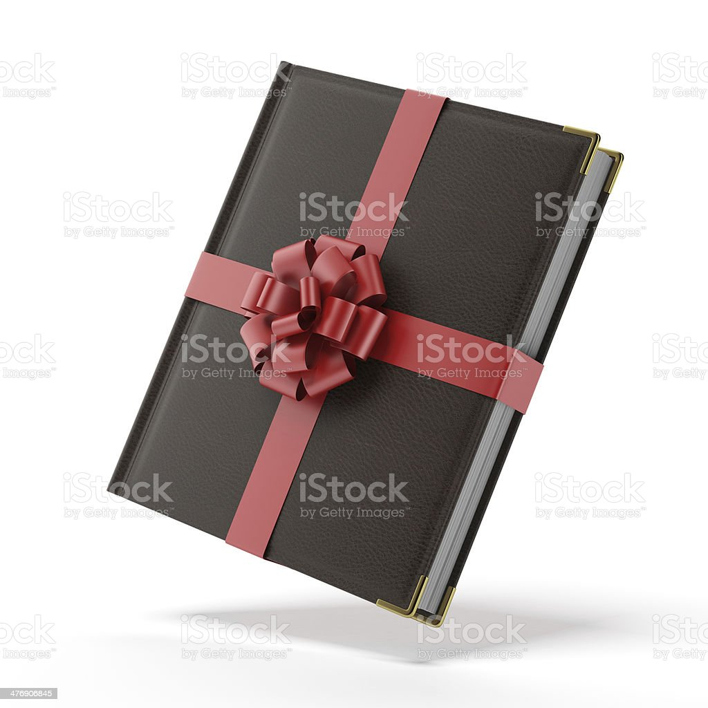 Book wrapped with a red ribbon stock photo