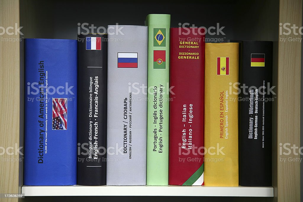 Bookcase with numerous foreign languages dictionaries. stock photo