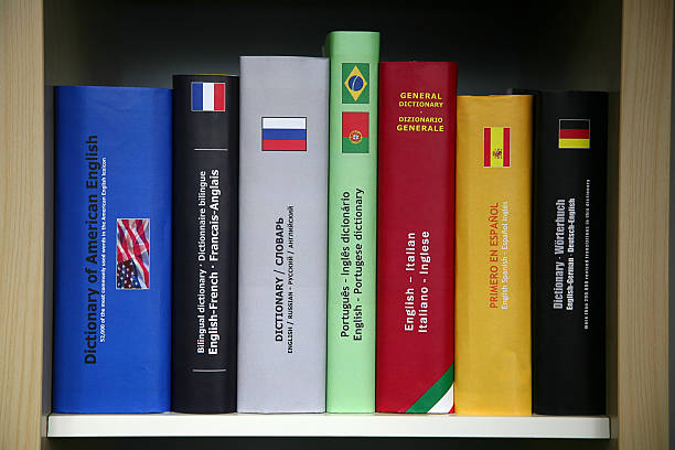 bookcase with numerous foreign languages dictionaries. - translator stock photos and pictures