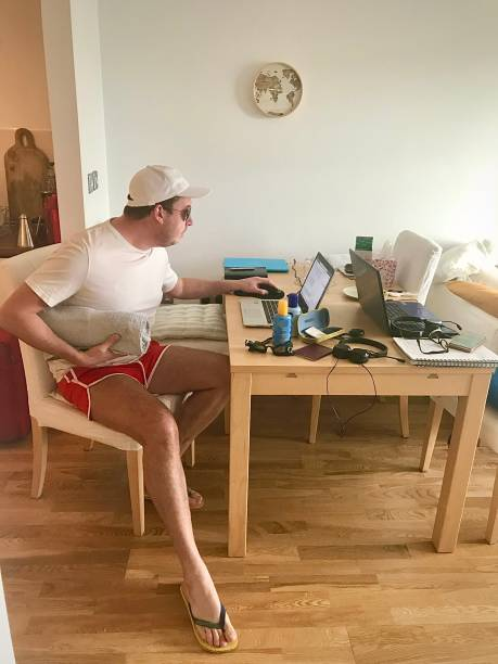 Booking a holiday while working from home. stock photo