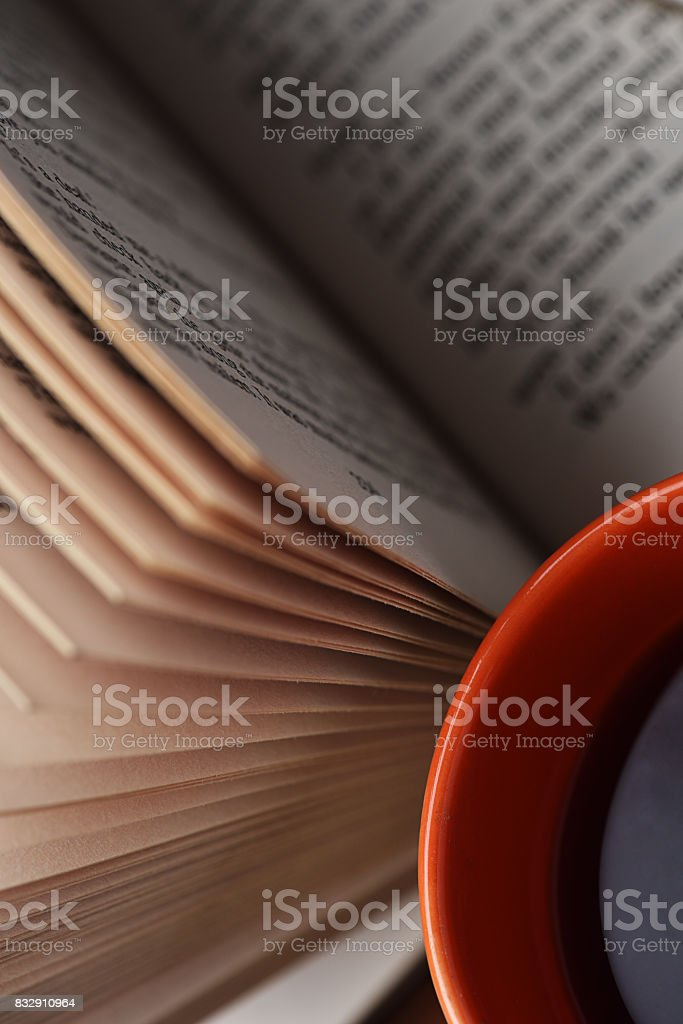 A Bookish Affair Book with a Tea cup Addiction Stock Photo