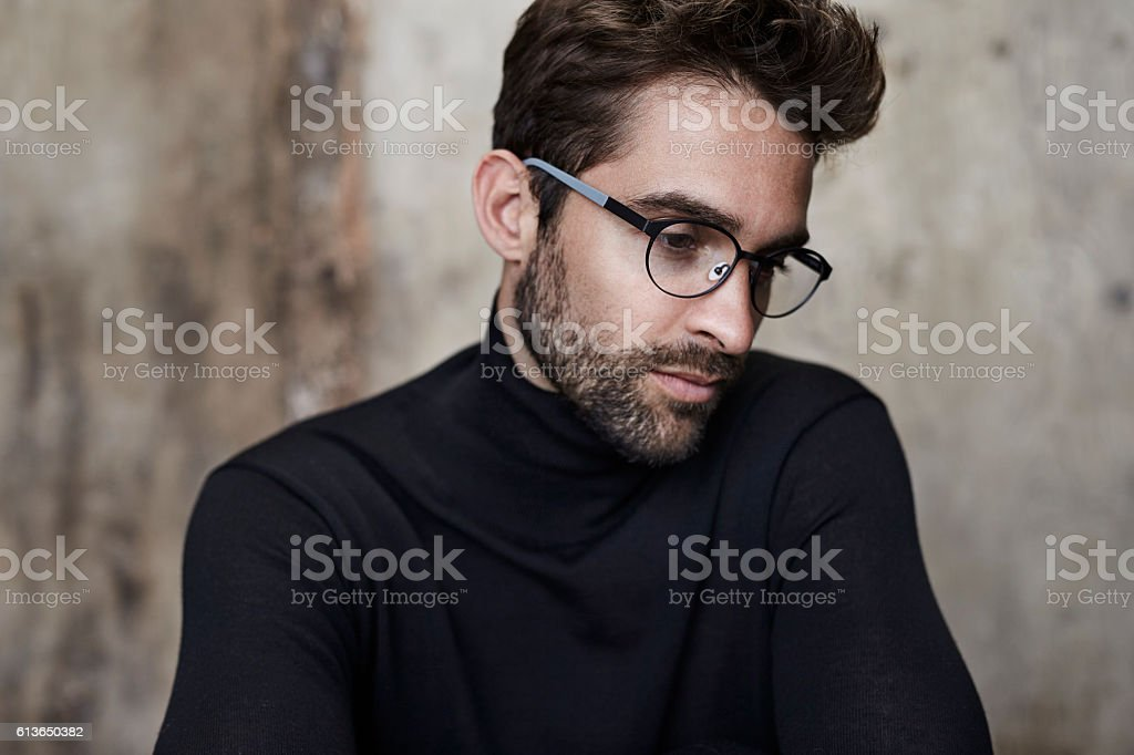 Bookish guy in black stock photo
