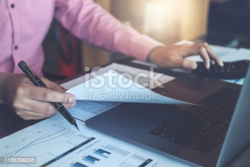 istock Bookkeeper accounting Concepts, Male use calculator, pen , and computer laptop to working financial and budget, inspector accountant concept. 1135266035