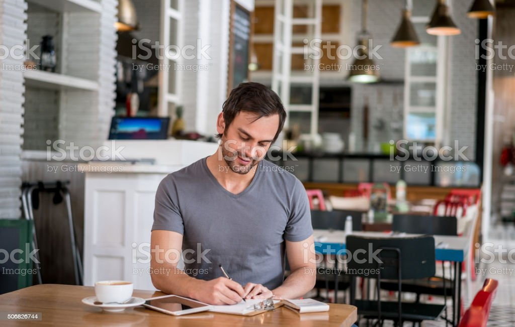 Bookkeeper working at a restaurant stock photo