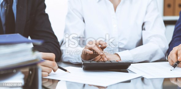 istock Bookkeepers team or financial inspectors  making report, calculating or checking balance. Tax service financial document. Audit concept. 1145018158