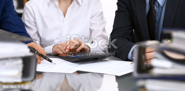 istock Bookkeepers team or financial inspectors  making report, calculating or checking balance. Tax service financial document. Audit concep 955166378